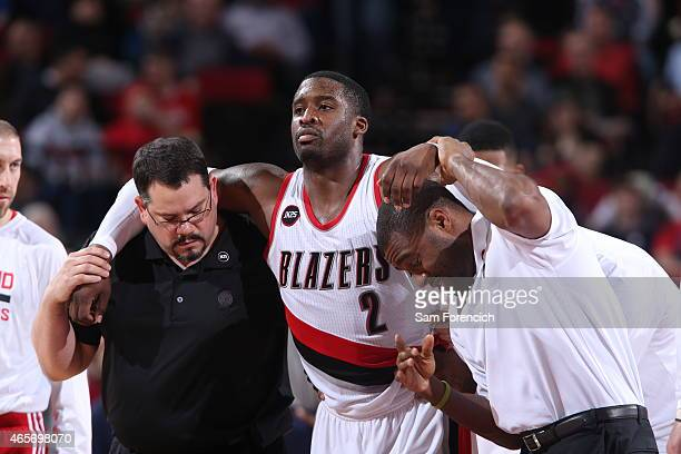 Wesley Matthews of the Portland Trail Blazers gets helped off the court during a game against the Dallas Mavericks on March 5 2015 at the Moda Center...