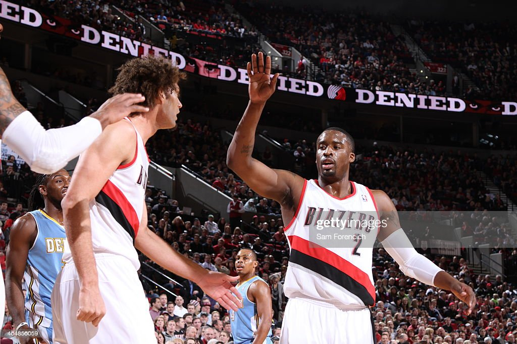 <a gi-track='captionPersonalityLinkClicked' href=/galleries/search?phrase=Wesley+Matthews&family=editorial&specificpeople=804816 ng-click='$event.stopPropagation()'>Wesley Matthews</a> #2 of the Portland Trail Blazers high fives teammates against the Denver Nuggets on January 23, 2014 at the Moda Center Arena in Portland, Oregon.