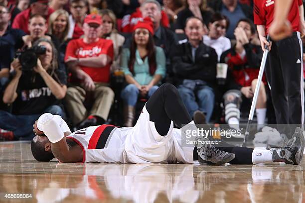 Wesley Matthews of the Portland Trail Blazers lays on the court during a game against the Dallas Mavericks on March 5 2015 at the Moda Center Arena...