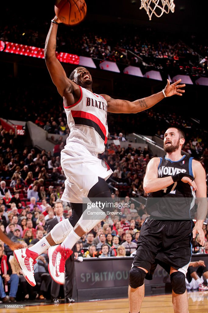 Wesley Matthews #2 of the Portland Trail Blazers rises for a dunk ahead of Kevin Love #42 of the Minnesota Timberwolves on November 23, 2012 at the Rose Garden Arena in Portland, Oregon.