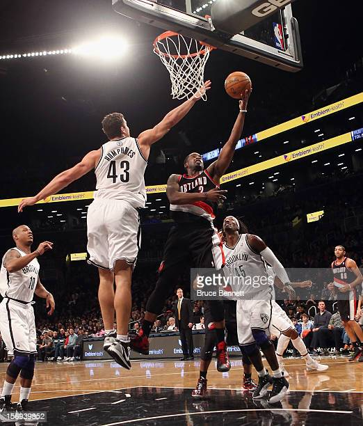 Wesley Matthews of the Portland Trail Blazers scores two in the first quarter against the Brooklyn Nets at the Barclays Center on November 25 2012 in...