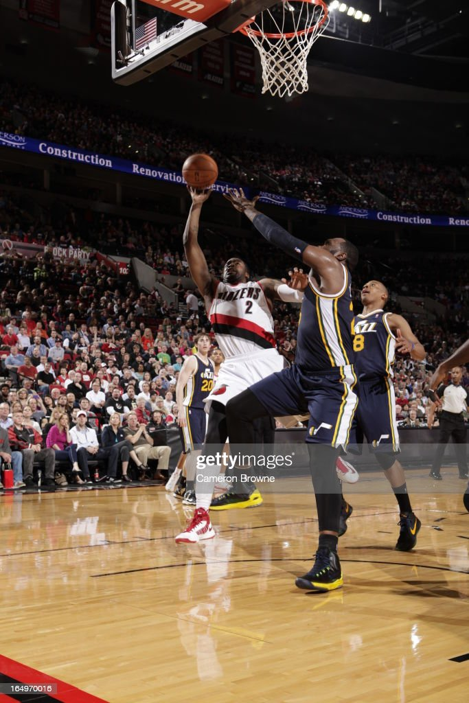 <a gi-track='captionPersonalityLinkClicked' href=/galleries/search?phrase=Wesley+Matthews&family=editorial&specificpeople=804816 ng-click='$event.stopPropagation()'>Wesley Matthews</a> #2 of the Portland Trail Blazers shoots against <a gi-track='captionPersonalityLinkClicked' href=/galleries/search?phrase=Al+Jefferson&family=editorial&specificpeople=201604 ng-click='$event.stopPropagation()'>Al Jefferson</a> #25 of the Utah Jazz on March 29, 2013 at the Rose Garden Arena in Portland, Oregon.