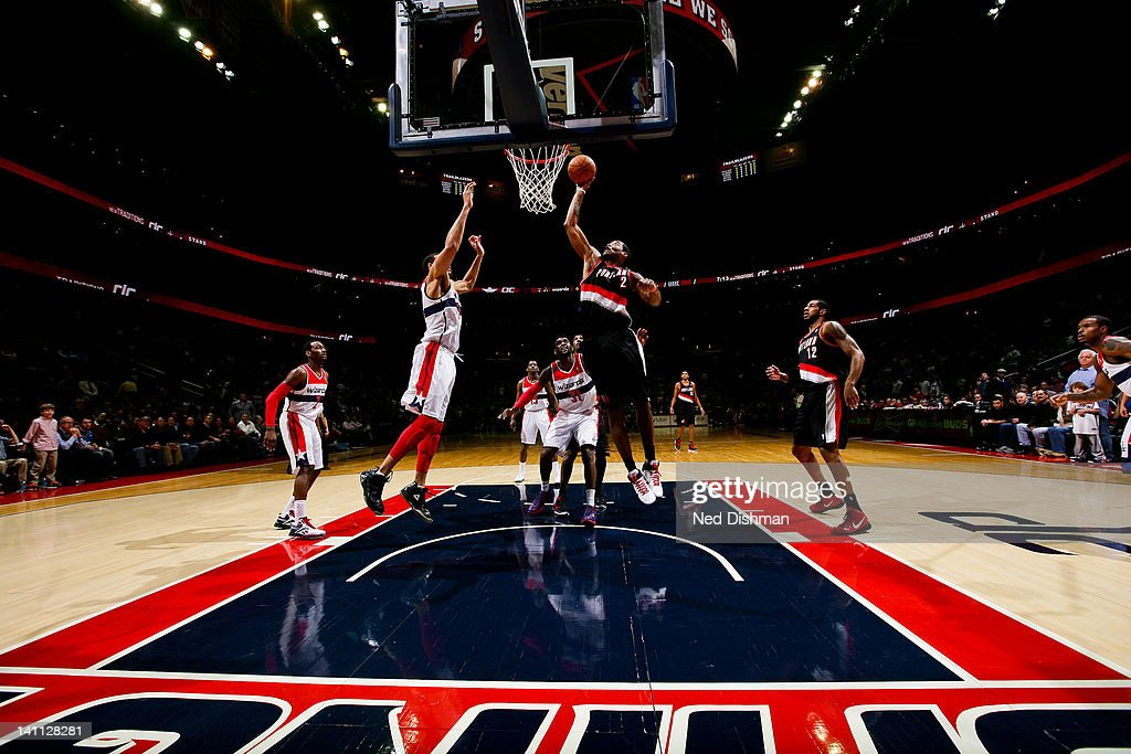 <a gi-track='captionPersonalityLinkClicked' href=/galleries/search?phrase=Wesley+Matthews&family=editorial&specificpeople=804816 ng-click='$event.stopPropagation()'>Wesley Matthews</a> #2 of the Portland Trail Blazers shoots against <a gi-track='captionPersonalityLinkClicked' href=/galleries/search?phrase=JaVale+McGee&family=editorial&specificpeople=4195625 ng-click='$event.stopPropagation()'>JaVale McGee</a> #34 of the Washington Wizards at the Verizon Center on March 10, 2012 in Washington, DC.
