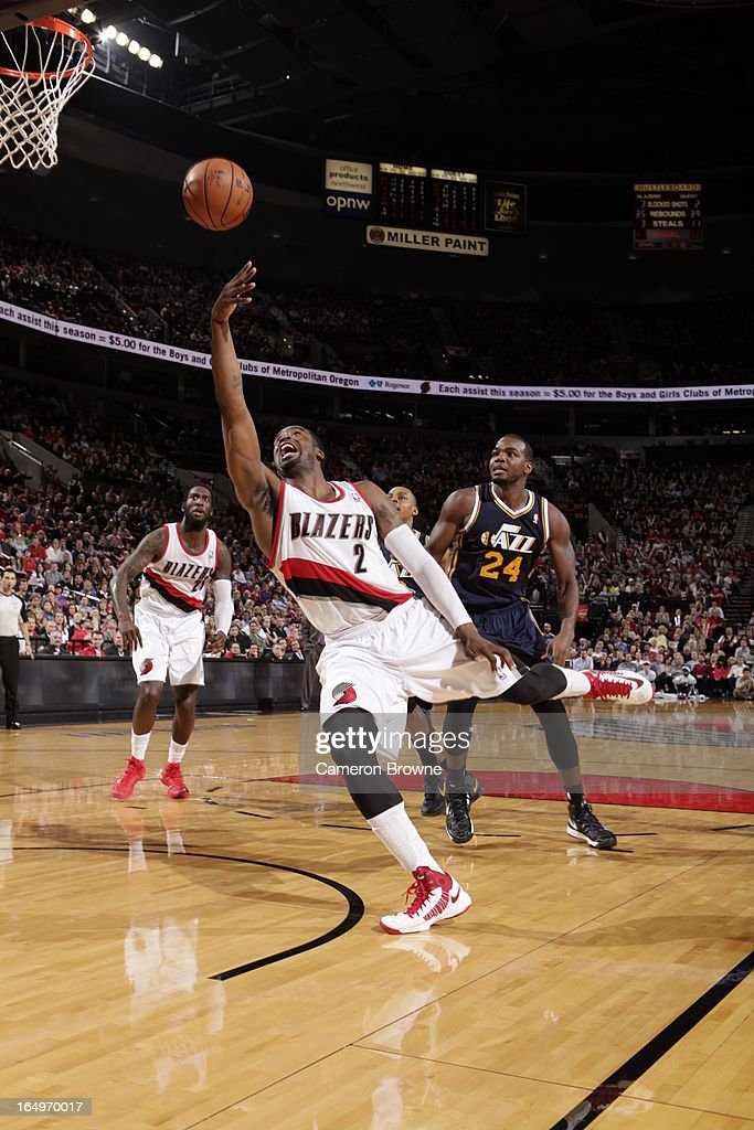 <a gi-track='captionPersonalityLinkClicked' href=/galleries/search?phrase=Wesley+Matthews&family=editorial&specificpeople=804816 ng-click='$event.stopPropagation()'>Wesley Matthews</a> #2 of the Portland Trail Blazers shoots against <a gi-track='captionPersonalityLinkClicked' href=/galleries/search?phrase=Paul+Millsap&family=editorial&specificpeople=880017 ng-click='$event.stopPropagation()'>Paul Millsap</a> #24 of the Utah Jazz on March 29, 2013 at the Rose Garden Arena in Portland, Oregon.