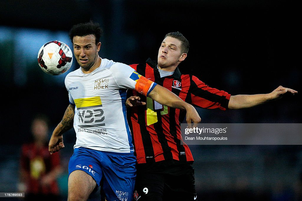 Wesley Meeuwsen of Rosmalen and Giovanni Siereveld of HSV Hoek battle for the ball during the First round Dutch Cup match between OJC Rosmalen and HSV Hoekse Sportvereniging Hoek at Sportpark De Groote Wielen on August 28, 2013 in Rosmalen, Netherlands.