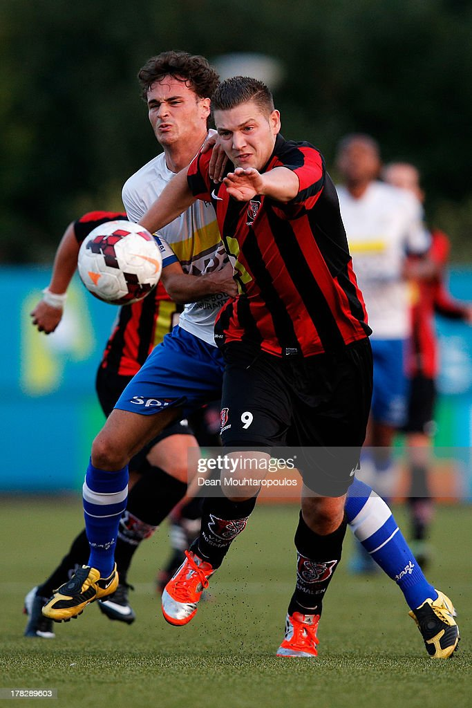 Wesley Meeuwsen (R) of Rosmalen and Thomas van Renterghem of HSV Hoek battle for the ball during the First round Dutch Cup match between OJC Rosmalen and HSV Hoekse Sportvereniging Hoek at Sportpark De Groote Wielen on August 28, 2013 in Rosmalen, Netherlands.