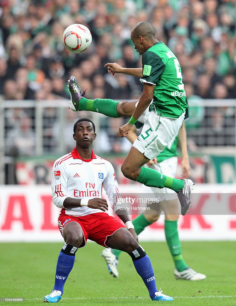 Wesley (R) of Bremen battles for the ball with <a gi-track='captionPersonalityLinkClicked' href=/galleries/search?phrase=Eljero+Elia&family=editorial&specificpeople=2199495 ng-click='$event.stopPropagation()'>Eljero Elia</a> of Hamburg during the Bundesliga match between SV Werder Bremen and Hamburger SV at Weser Stadium on September 25, 2010 in Bremen, Germany.