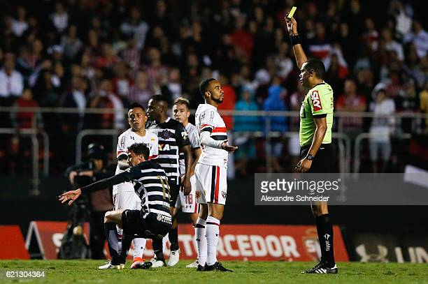 Wesley of Sao Paulo receives the yelloy card during the match between Sao Paulo and Corinthians for the Brazilian Series A 2016 at Mrumbi stadium on...
