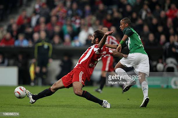 Wesley of Werder Bremen and Hamit Altintop of Bayern Muenchen battle for the ball during the DFB Cup second round match between FC Bayern Muenchen...