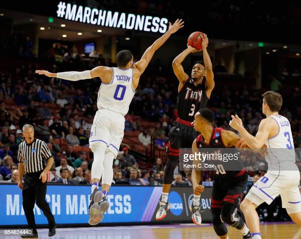 Wesley Person of the Troy Trojans shot is blocked by Jayson Tatum of the Duke Blue Devils in the first half during the first round of the 2017 NCAA...