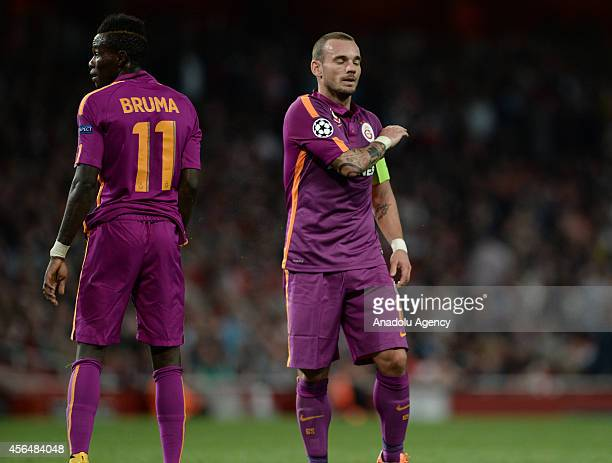 Wesley Sneijder and Bruma of Galatasaray react during the UEFA Champions League Group D football match between Arsenal FC and Galatasaray AS at...