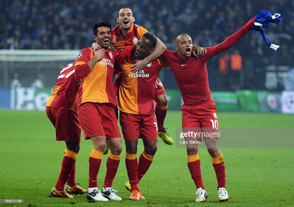 <a gi-track='captionPersonalityLinkClicked' href=/galleries/search?phrase=Wesley+Sneijder&family=editorial&specificpeople=538145 ng-click='$event.stopPropagation()'>Wesley Sneijder</a> and <a gi-track='captionPersonalityLinkClicked' href=/galleries/search?phrase=Didier+Drogba&family=editorial&specificpeople=179398 ng-click='$event.stopPropagation()'>Didier Drogba</a> of Galatasaray celebrate with team mates Goekhan Zan and <a gi-track='captionPersonalityLinkClicked' href=/galleries/search?phrase=Felipe+Melo&family=editorial&specificpeople=646942 ng-click='$event.stopPropagation()'>Felipe Melo</a> after winning the UEFA Champions League round of 16 second leg match between FC Schalke 04 and Galatasaray AS at Veltins-Arena on March 12, 2013 in Gelsenkirchen, Germany.