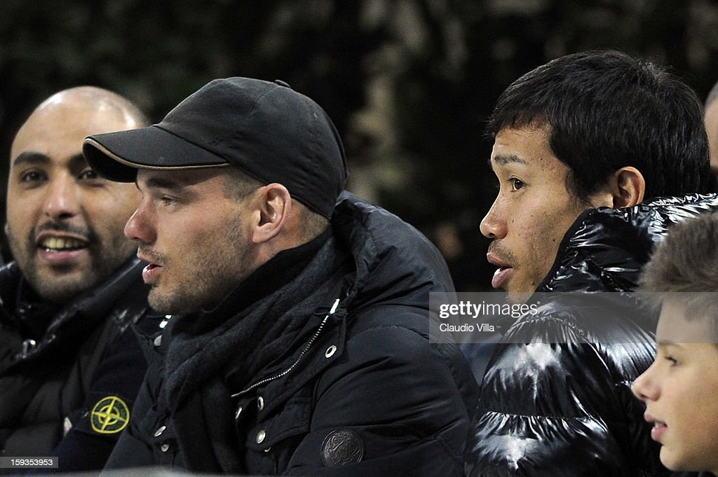 Wesley Sneijder (L) and Yuto Nagatomo of FC Inter Milan watch the Serie A match between FC Internazionale Milano and Pescara at San Siro Stadium on January 12, 2013 in Milan, Italy.