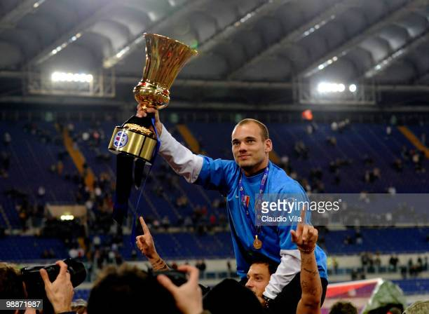 Wesley Sneijder celebrates with the trophy after the Tim Cup final between FC Internazionale Milano and AS Roma at Stadio Olimpico on May 5 2010 in...