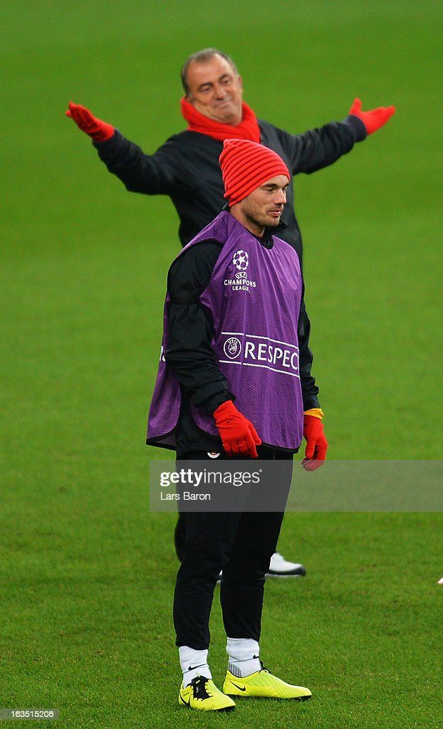 <a gi-track='captionPersonalityLinkClicked' href=/galleries/search?phrase=Wesley+Sneijder&family=editorial&specificpeople=538145 ng-click='$event.stopPropagation()'>Wesley Sneijder</a> is seen next to head coach <a gi-track='captionPersonalityLinkClicked' href=/galleries/search?phrase=Fatih+Terim&family=editorial&specificpeople=602376 ng-click='$event.stopPropagation()'>Fatih Terim</a> during a Galatasaray AS training session ahead of their UEFA Champions League round of 16 match against FC Schalke 04 at Veltins Arena on March 11, 2013 in Gelsenkirchen, Germany.