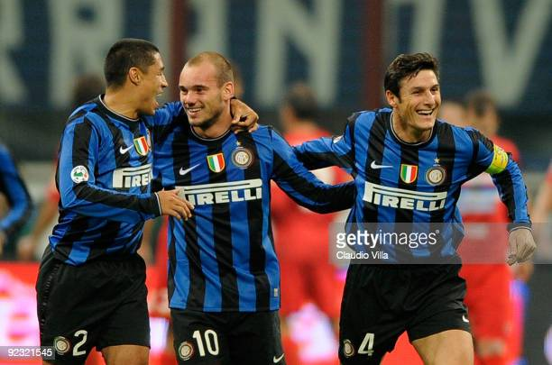 Wesley Sneijder Ivan Ramiro Cordoba and Javier Zanetti of FC Internazionale Milano celebrate after the second goal during the Serie A match between...