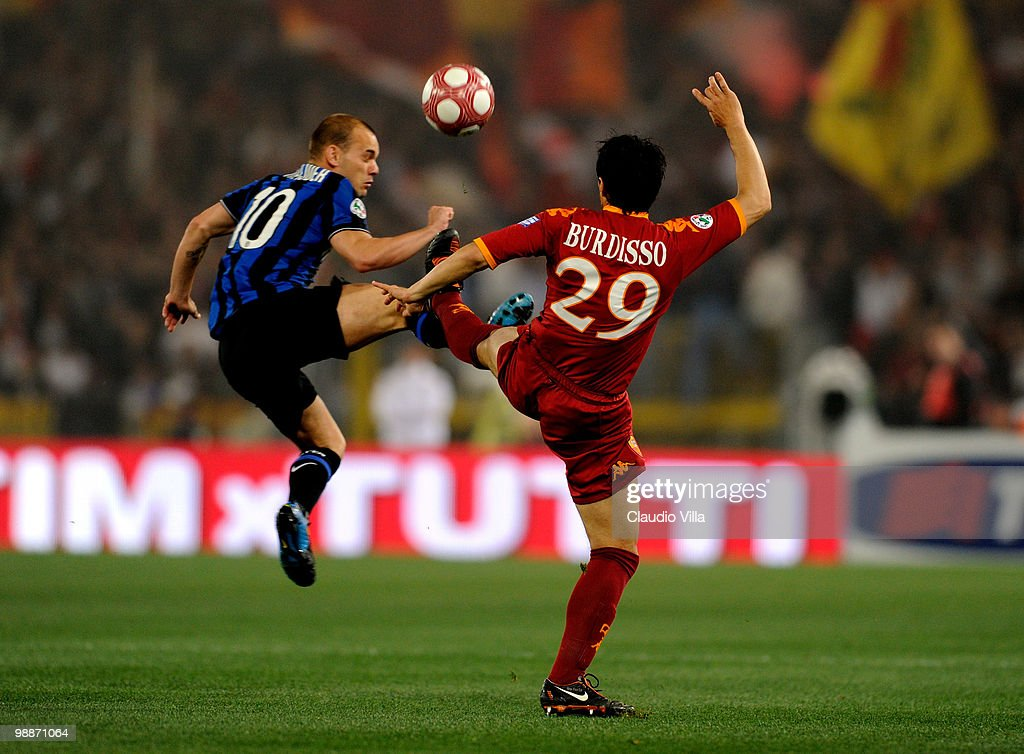 <a gi-track='captionPersonalityLinkClicked' href=/galleries/search?phrase=Wesley+Sneijder&family=editorial&specificpeople=538145 ng-click='$event.stopPropagation()'>Wesley Sneijder</a> of FC Inter Milan is injured during a tackle by <a gi-track='captionPersonalityLinkClicked' href=/galleries/search?phrase=Nicolas+Burdisso&family=editorial&specificpeople=490963 ng-click='$event.stopPropagation()'>Nicolas Burdisso</a> (R) of AS Roma during the Tim Cup final between FC Internazionale Milano and AS Roma at Stadio Olimpico on May 5, 2010 in Rome, Italy.