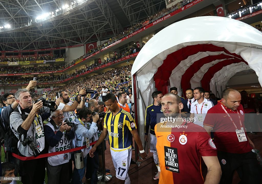 Wesley Sneijder of Galatasaray (right 2) and Luis Nani of Fenerbahce are seen as the players enter to picth piror to the Ziraat Turkish Cup Final match between Galatasaray and Fenerbahce at Antalya Ataturk Stadium in Antalya, Turkey on May 26, 2016.