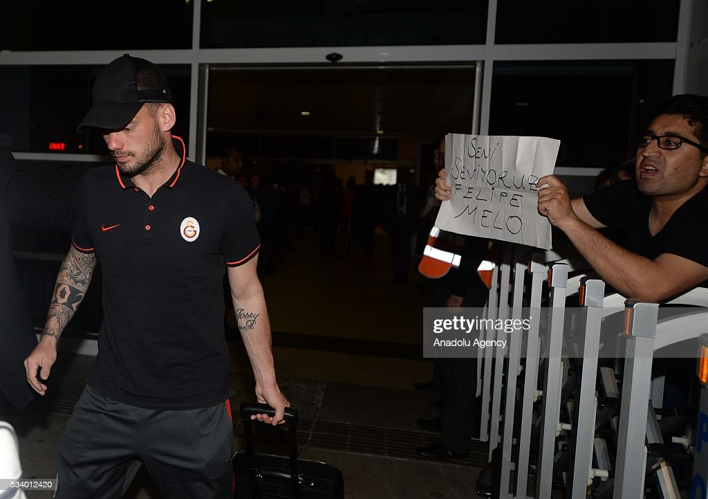 Wesley Sneijder (L) of Galatasaray carries his luggage during their arrival at Antalya Airport for Ziraat Turkish Cup final match against Fenerbahce in Antalya, Turkey on May 24, 2016.