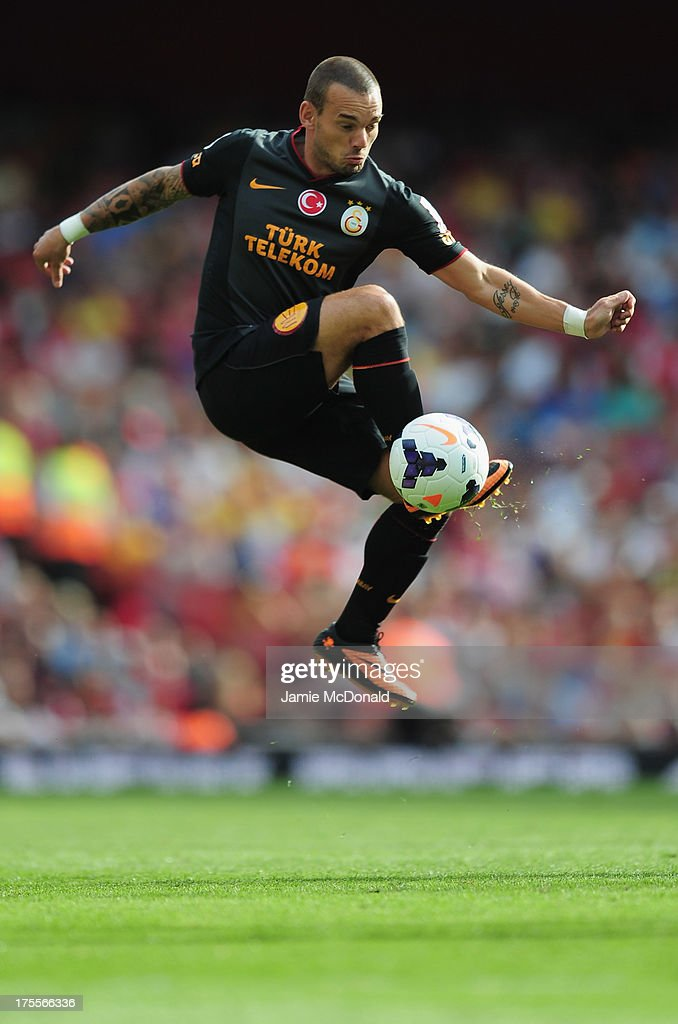 <a gi-track='captionPersonalityLinkClicked' href=/galleries/search?phrase=Wesley+Sneijder&family=editorial&specificpeople=538145 ng-click='$event.stopPropagation()'>Wesley Sneijder</a> of Galatasaray in action during the Emirates Cup match between Arsenal and Galatasaray at the Emirates Stadium on August 4, 2013 in London, England.