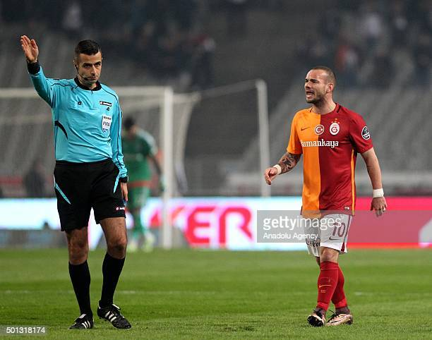 Wesley Sneijder of Galatasaray reacts to referee Mete Kalkavan during the Turkish Spor Toto Super League football match between Besiktas and...