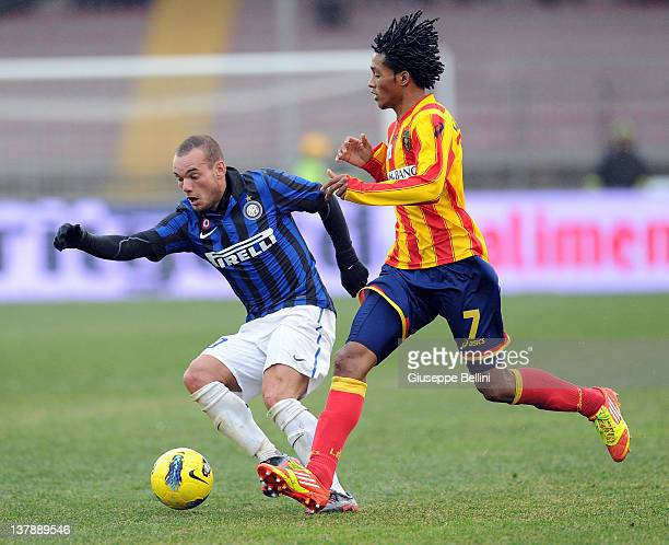 Wesley Sneijder of Inter Milan and Guillermo Cuadrado of US Lecce in action during the Serie A match between US Lecce and FC Internazionale Milano at...