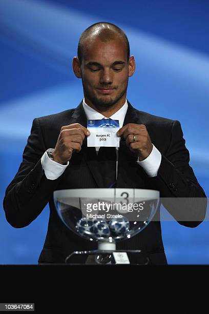 Wesley Sneijder of Inter Milan and Holland draws the name of Glasgow Rangers during the UEFA Champions League Group Stage draw at the Grimaldi Forum...