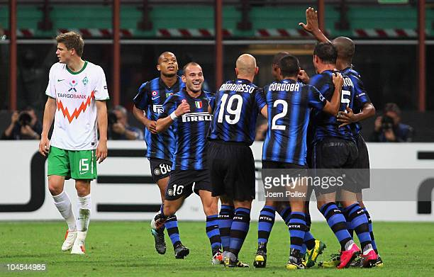 Wesley Sneijder of Milano celebrates with his team mates after scoring his team's third goal during the UEFA Champions League group A match between...