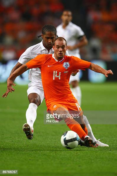 Wesley Sneijder of Netherlands holds back Glen Johnson of England during the International Friendly between Netherlands and England at the Amsterdam...