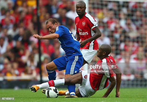 Wesley Sneijder of Real Madrid battles for the ball with Abou Diaby of Arsenal during the preseason friendly match between Arsenal and Real Madrid...