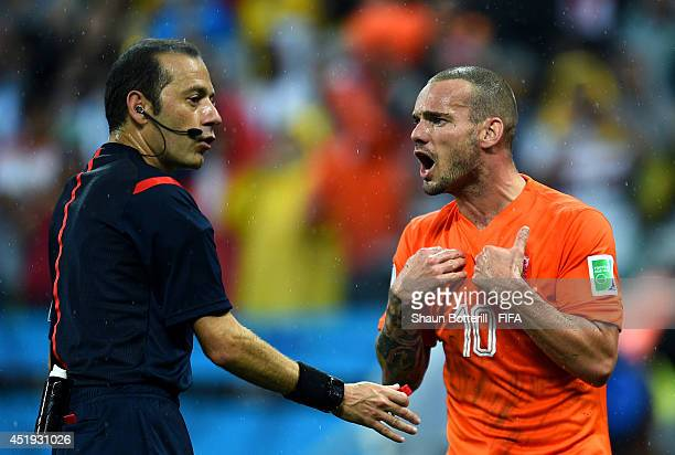 Wesley Sneijder of the Netherlands appeals to referee Cuneyt Cakir during the 2014 FIFA World Cup Brazil Semi Final match between Netherlands and...