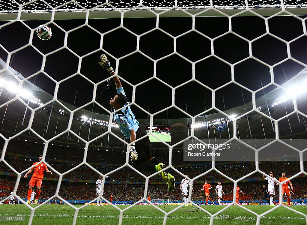 Wesley Sneijder of the Netherlands attempts a shot at goal against Keylor Navas of Costa Rica and hits the crossbar during the 2014 FIFA World Cup Brazil Quarter Final match between the Netherlands and Costa Rica at Arena Fonte Nova on July 5, 2014 in Salvador, Brazil.