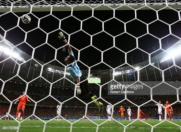 Wesley Sneijder of the Netherlands attempts a shot at goal against Keylor Navas of Costa Rica and hits the crossbar during the 2014 FIFA World Cup...