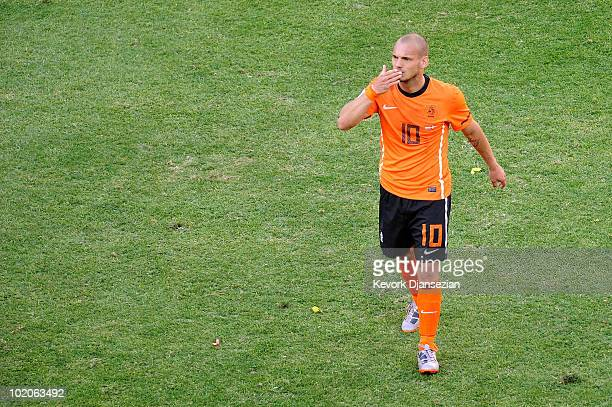 Wesley Sneijder of the Netherlands blows a kiss to fans after victory in the 2010 FIFA World Cup Group E match between Netherlands and Denmark at...