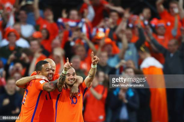 Wesley Sneijder of the Netherlands celebrates scoring a goal with team mates during the FIFA 2018 World Cup Qualifier between the Netherlands and...