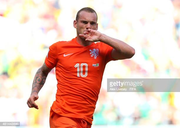 Wesley Sneijder of the Netherlands celebrates scoring his team's first goal during the 2014 FIFA World Cup Brazil Round of 16 match between...