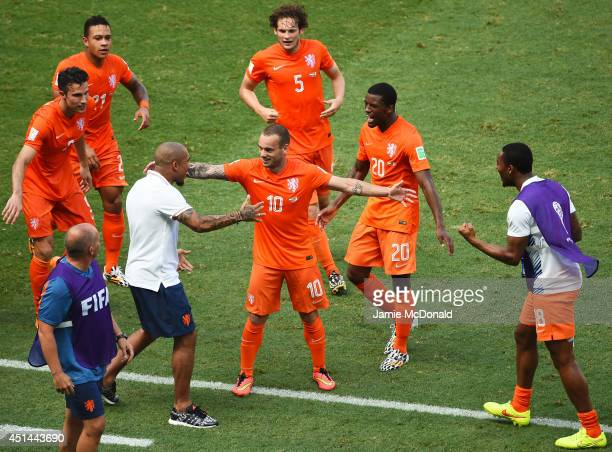 Wesley Sneijder of the Netherlands celebrates scoring his team's first goal with teammates during the 2014 FIFA World Cup Brazil Round of 16 match...