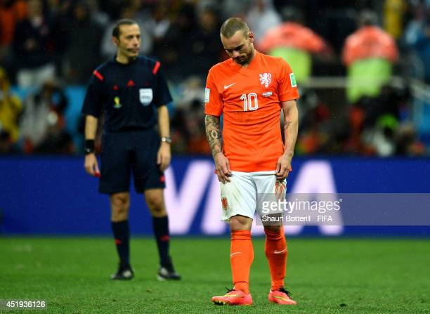 Wesley Sneijder of the Netherlands reacts after his penalty kick saved in the penalty shootout during the 2014 FIFA World Cup Brazil Semi Final match...