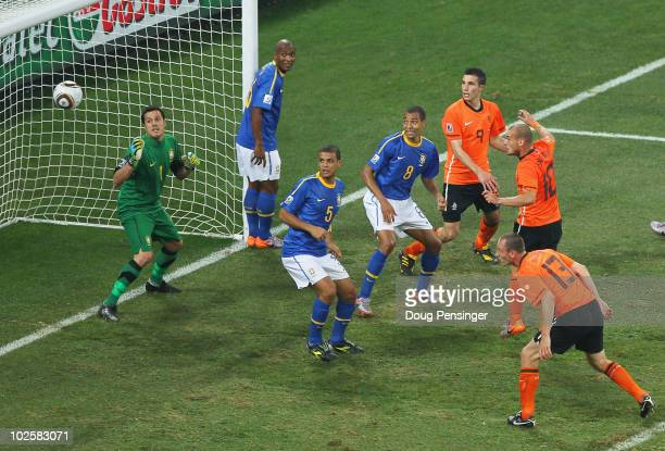 Wesley Sneijder of the Netherlands scores his side's second goal past Julio Cesar of Brazil during the 2010 FIFA World Cup South Africa Quarter Final...