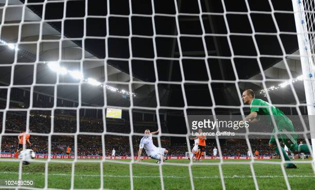 Wesley Sneijder of the Netherlands scores the second goal for his team past Jan Mucha of Slovakia during the 2010 FIFA World Cup South Africa Round...