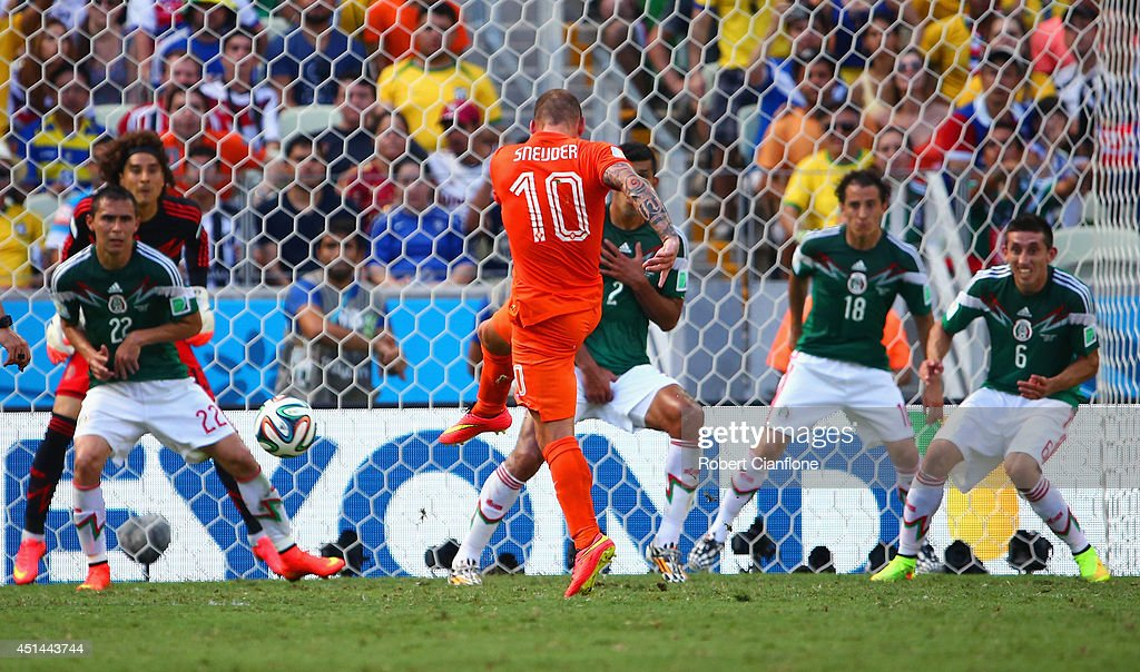 <a gi-track='captionPersonalityLinkClicked' href=/galleries/search?phrase=Wesley+Sneijder&family=editorial&specificpeople=538145 ng-click='$event.stopPropagation()'>Wesley Sneijder</a> of the Netherlands shoots and scores his team's first goal past <a gi-track='captionPersonalityLinkClicked' href=/galleries/search?phrase=Guillermo+Ochoa&family=editorial&specificpeople=490875 ng-click='$event.stopPropagation()'>Guillermo Ochoa</a> of Mexico during the 2014 FIFA World Cup Brazil Round of 16 match between Netherlands and Mexico at Castelao on June 29, 2014 in Fortaleza, Brazil.