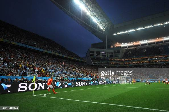 Wesley Sneijder of the Netherlands takes a corner kick during the 2014 FIFA World Cup Brazil Semi Final match between Netherlands and Argentina at...