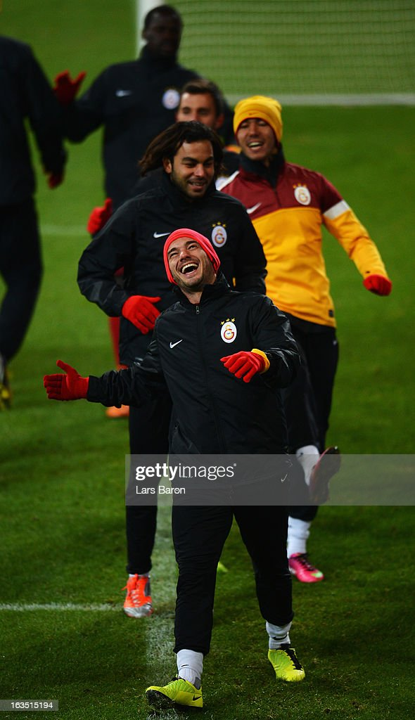 <a gi-track='captionPersonalityLinkClicked' href=/galleries/search?phrase=Wesley+Sneijder&family=editorial&specificpeople=538145 ng-click='$event.stopPropagation()'>Wesley Sneijder</a> smiles during a Galatasaray AS training session ahead of their UEFA Champions League round of 16 match against FC Schalke 04 at Veltins Arena on March 11, 2013 in Gelsenkirchen, Germany.