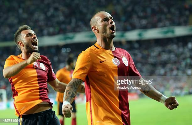 Wesley Sneijder with his teammates of Galatasaray celebrates after a goal during the Turkish Spor Toto Super League football match between Torku...