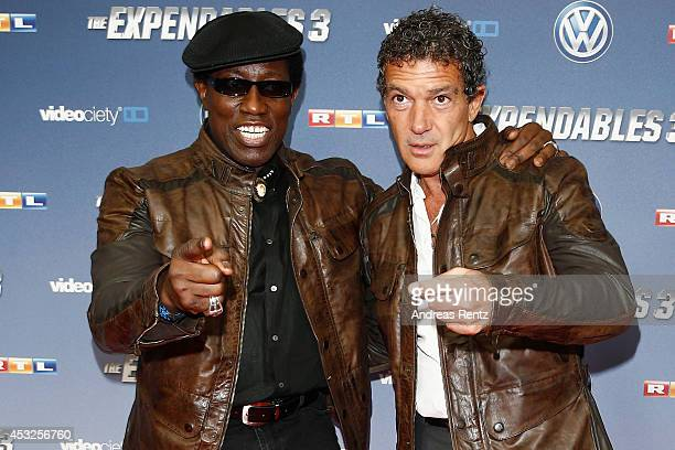 Wesley Snipes and Antonio Banderas attend the German premiere of the film 'The Expendables 3' at Residenz Kino on August 6 2014 in Cologne Germany