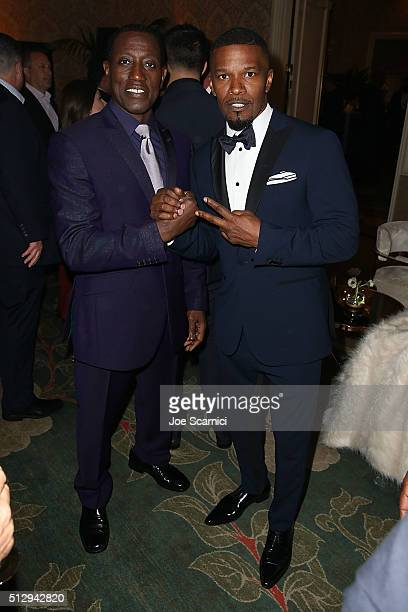 Wesley Snipes and Jamie Foxx attend the MercedesBenz and African American Film Critics Association Oscar viewing party at Four Seasons Hotel Beverly...