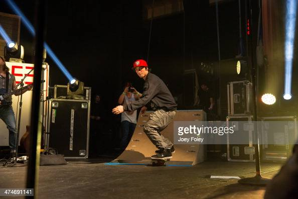 Wesley Stromberg of Emblem3 skateboarding onstage as they perform live onstage at Bankers Life Fieldhouse on February 15 2014 in Indianapolis Indiana