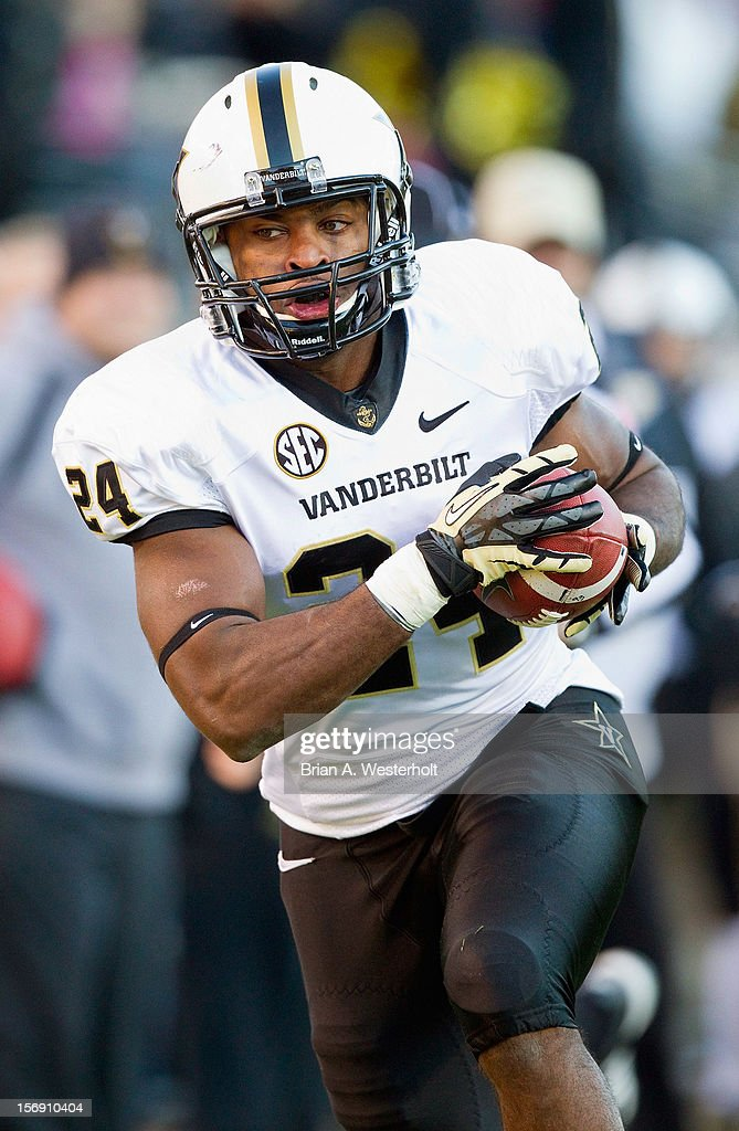 Wesley Tate #24 of the Vanderbilt Commodores catches a 25-yard touchdown pass during first quarter action against the Wake Forest Demon Deacons at BB&T Field on November 24, 2012 in Winston Salem, North Carolina. The Commodores defeated the Demon Deacons 55-21.