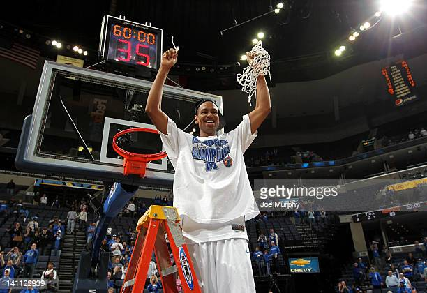Wesley Witherspoon of the Memphis Tigers cuts down the net against the Marshall Thundering Herd during the Championship of the 2012 CUSA men's...