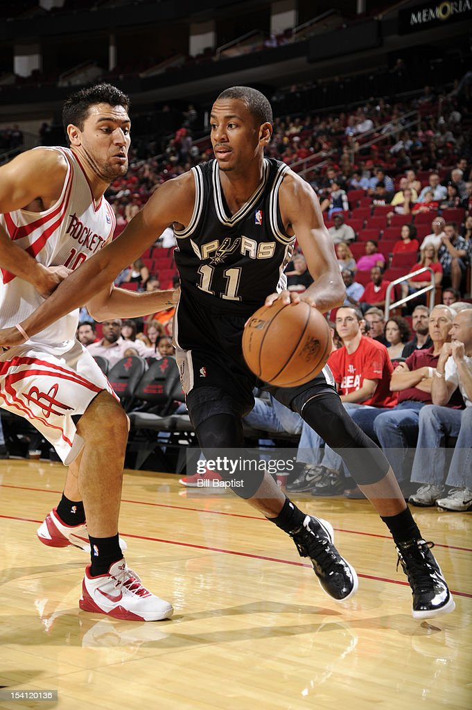 Wesley Witherspoon #11 of the San Antonio Spurs drives the ball against <a gi-track='captionPersonalityLinkClicked' href=/galleries/search?phrase=Carlos+Delfino&family=editorial&specificpeople=206625 ng-click='$event.stopPropagation()'>Carlos Delfino</a> #10 of the Houston Rockets during a pre-season game on October 14, 2012 at the Toyota Center in Houston, Texas.